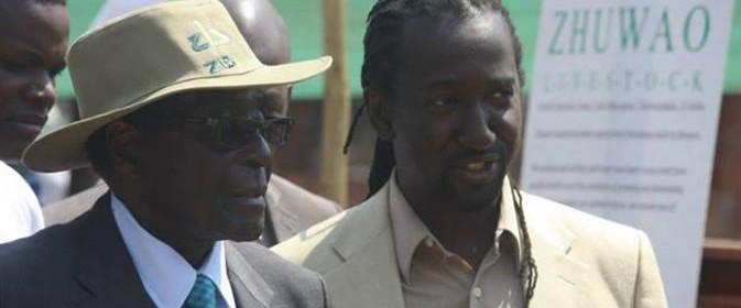 Mugabe-with-Patrick-Zhuwao-e1423322411463