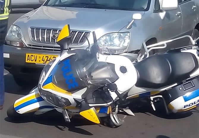 Mugabe-police-biker-accident