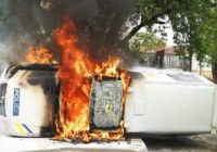 WHITE FARMERS STORMED THE SEKAL MAGISTRATES COURT BUILDING  ON TUESDAY AND SET A POLICE CAR ON FIRE, demanding that the suspects who are accused of killing a white farmer be handed over to them.